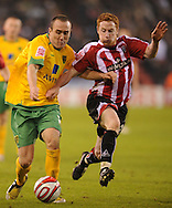 Sheffield - Saturday January 9th, 2009: Greg Halford of Sheffield United and Lee Croft of Norwich City during the Coca Cola Championship match at Bramall Lane, Sheffield. (Pic by Alex Broadway/Focus Images)