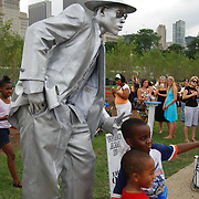 Chicago's Original Tin Man performs during the Taste of Chicago street festival.