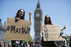 © Licensed to London News Pictures. 10/06/2017. London, UK. People protest against Prime Minister Theresa May's new government and a coalition with the DUP in Parliament Square, London on Saturday, 10 June 2017 as the UK snap general election leads to a hung parliament. Photo credit: Tolga Akmen/LNP