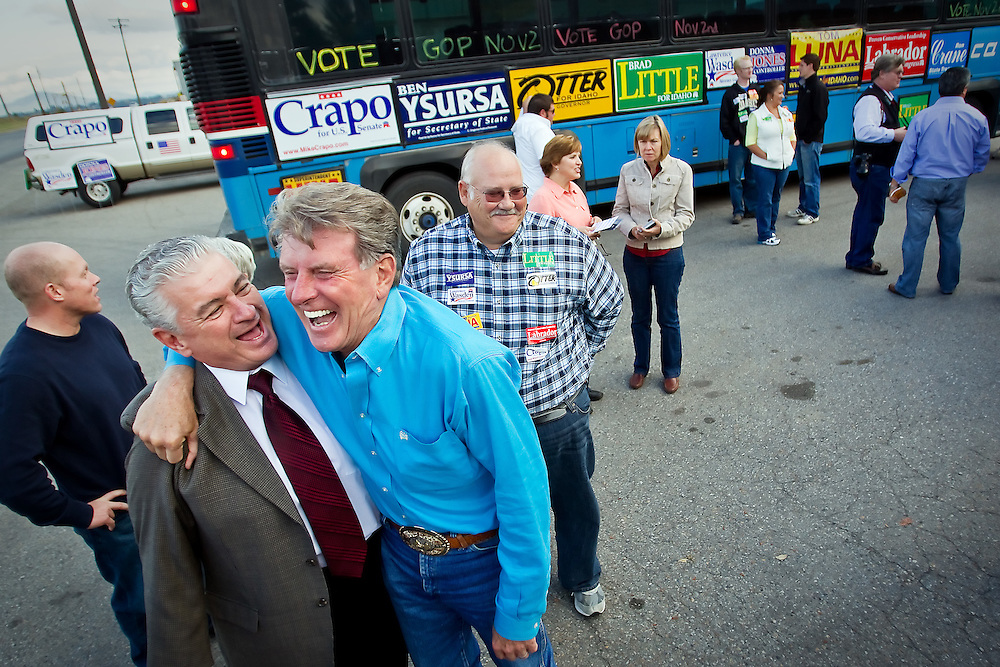 Gov. Butch Otter, right, and Ron Nilson share a laugh during a stop at Idaho Veneer in Post Falls on the GOP bus tour Friday. Republican officials and candidates representing North Idaho and the state visited with supporters during the stops in Hayden, Post Falls and Coeur d'Alene.