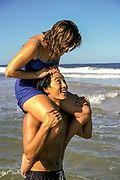 Australia, Queensland, man with woman on his shoulders. people ****Model Release available