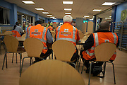 Postal workers rest in the canteen during a night shift at Royal Mail's DIRFT logistics park in Daventry, Northamptonshire England.