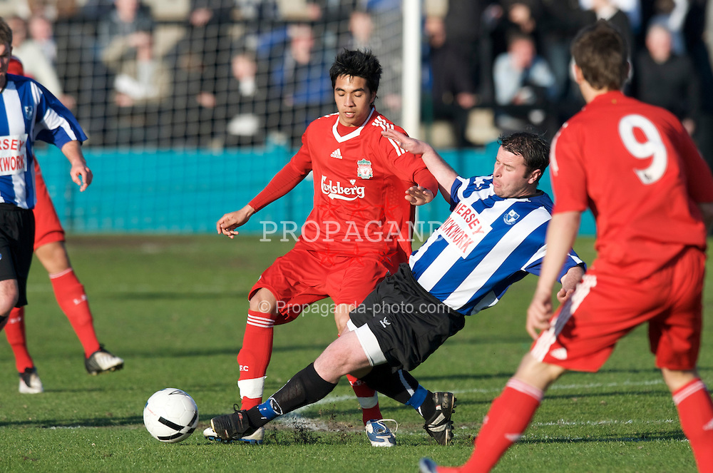 LIVERPOOL, ENGLAND - Monday, April 27, 2009: Liverpool's Gerardo Alfredo Bruna Blanco and Waterloo Dock's Eddie O'Brian during the Liverpool Senior Cup Final at the Arriva Stadium. (Photo by David Rawcliffe/Propaganda)