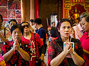 16 FEBRUARY 2018 - BANGKOK, THAILAND: People light incense and pray at Wat Mangkon Kamalawat during Chinese New Year celebrations in the Chinatown neighborhood of Bangkok. Thailand has a large Chinese community and Lunar New Year is widely celebrated, especially in larger cities. This will be the Year of the Dog.       PHOTO BY JACK KURTZ