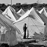 A Syrian refugee beside a tent inside a refugee camp in Reyhanli, Turkey, Saturday, March 17, 2012. The number of Syrian refugees in Turkey is now about 17,000. March 2012.