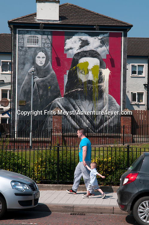 Londonderry, Northern Ireland, July 2013. 'Welcome to free Derry' says a sign entering the Bogside of Derry. The Boside is world famous for events including the outbreak of the Troubles in 1968, the battle of the Bogside and most notably BLOODY SUNDAY in 1972. Nowadays the graphic and colourful murals are the attracting for tourists who visit the area. It is the first time that Tallship Thalassa, a barquentine sailing vessel with 3 masts, sails from Belfast to Galway along the Irish coastline. While a full-rigged ship is square-rigged on all three masts, and the barque is square-rigged on the foremast and main, the barquentine extends the principle by making only the foremast square-rigged. The advantages of a smaller crew, good performance before the wind and the ability to sail relatively close to the wind while carrying plenty of cargo made it a popular rig at the end of the 19th century. Photo by Frits Meyst/Adventure4ver.com