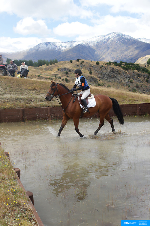 Mary-Jane Spring dining Te Kuti in action at the water jump during the Cross Country event at the Wakatipu One Day Horse Trials at the Pony Club grounds,  Queenstown, Otago, New Zealand. 15th January 2012. Photo Tim Clayton