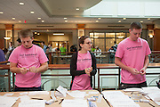 Dan Maloney, Kathy Wiener and Sam Rosenthal help students at the Got Swabbed event in the Baker Center at Ohio University on Tuesday, October 15, 2013. Photo by Chris Franz