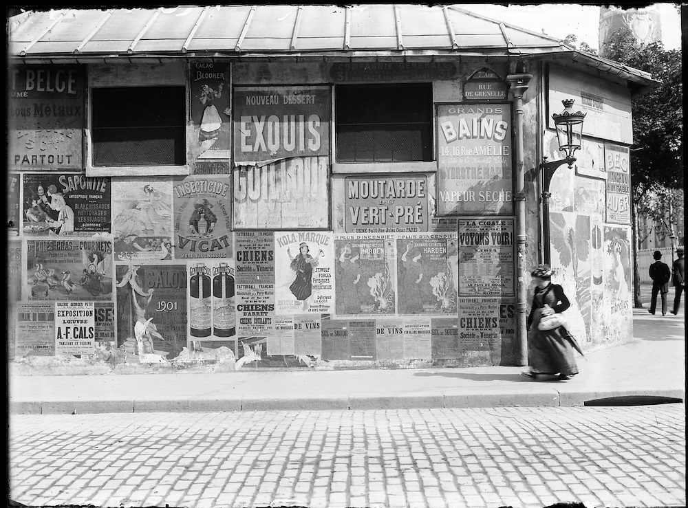 street posters on Rue de Grenelle, Paris France around 1900