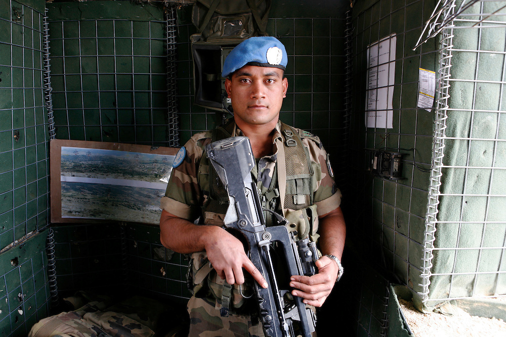 "Originally created in 1978, The United Nations Interim Force in Lebanon (UNIFIL) was created to ensure oversee an Israeli withdrawal from Lebanon, who at that time began its occupation of southern Lebanon that lasted until 2000. After the Israeli war on Lebanon in 2006, UNIFIL enhanced its presence in southern Lebanon to monitor the cessation of hostilities. ..Pictured: A French soldier stands in a tower looking over the hills of southern Lebanon at the UNIFIL French camp ""2.45"" in al-Tiri."