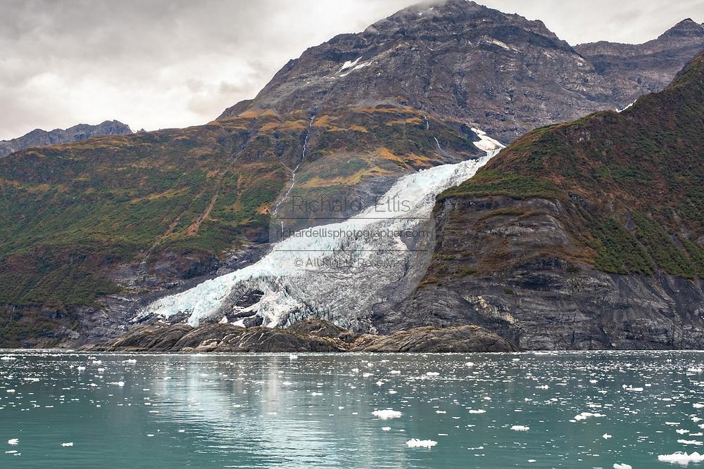 Cascade glacier melting into Barry Arm in Harriman Fjord, Prince William Sound near Whittier, Alaska.