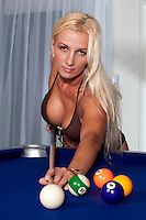 30 something caucasian woman playing pool in bikini.