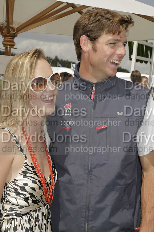 Ellie Shepherd and Dan Philipson. Cartier International Polo. Guards Polo Club. Windsor Great Park. 30 July 2006. ONE TIME USE ONLY - DO NOT ARCHIVE  © Copyright Photograph by Dafydd Jones 66 Stockwell Park Rd. London SW9 0DA Tel 020 7733 0108 www.dafjones.com