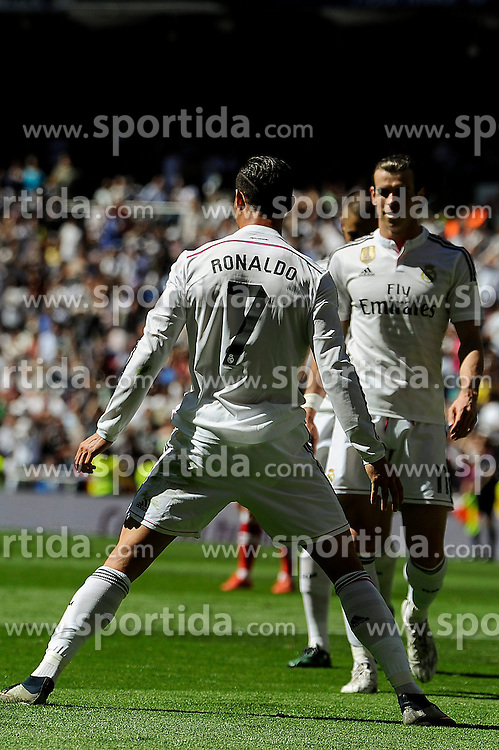 05.04.2015, Estadio Santiago Bernabeu, Madrid, ESP, Primera Division, Real Madrid vs FC Granada, 29. Runde, im Bild Real Madrid&acute;s Cristiano Ronaldo and Gareth Bale celebrates a goal // during the Spanish Primera Division 29th round match between Real Madrid CF and FC Granada at the Estadio Santiago Bernabeu in Madrid, Spain on 2015/04/05. EXPA Pictures &copy; 2015, PhotoCredit: EXPA/ Alterphotos/ Luis Fernandez<br /> <br /> *****ATTENTION - OUT of ESP, SUI*****