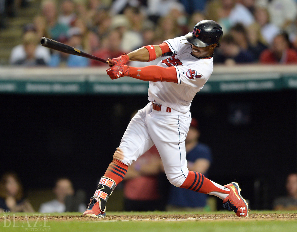 Sep 3, 2016; Cleveland, OH, USA; Cleveland Indians shortstop Francisco Lindor (12) hits an hits an RBI single during the sixth inning against the Miami Marlins at Progressive Field. Mandatory Credit: Ken Blaze-USA TODAY Sports