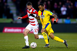 Jordan Ayew of Crystal Palace takes on Matty Blair of Doncaster Rovers - Mandatory by-line: Robbie Stephenson/JMP - 17/02/2019 - FOOTBALL - The Keepmoat Stadium - Doncaster, England - Doncaster Rovers v Crystal Palace - Emirates FA Cup fifth round proper