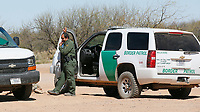 U.S. Customs and Border Protection agents talk near the U.S. - Mexico border that crosses the Tohono O'odham reservation in Chukut Kuk, Arizona April 6, 2017. Picture taken April 6, 2017.  REUTERS/Rick Wilking