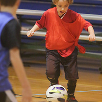 Cole Jones dribbles Sunday January 18, 2015 at the Wilmington Family YMCA. (Jason A. Frizzelle)