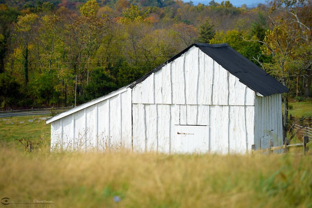 Weathered farm shed on the property of the Joseph Poffenberger Farm Antietam National Battlefield Sharpsburg Maryland USA.