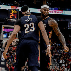 Oct 20, 2017; New Orleans, LA, USA; New Orleans Pelicans forward Anthony Davis (23) and forward DeMarcus Cousins (0) celebrate after a basket during the second half of a game against the Golden State Warriors at the Smoothie King Center. The Warriors defeated the Pelicans 128-120.  Mandatory Credit: Derick E. Hingle-USA TODAY Sports