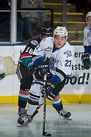 KELOWNA, CANADA - OCTOBER 4: Jared Legien #23 of the Victoria Royals is checked from behind by Kole Lind #16 of the Kelowna Rockets on October 4, 2017 at Prospera Place in Kelowna, British Columbia, Canada.  (Photo by Marissa Baecker/Shoot the Breeze)  *** Local Caption ***