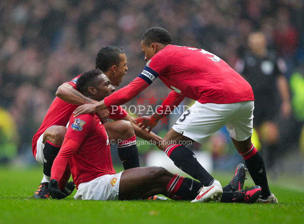 MANCHESTER, ENGLAND - Sunday, January 8, 2012: Manchester United's Danny Welbeck celebrates scoring the second goal against Manchester City with team-mate Patrice Evra, Rio Ferdinand, Michael Carrick and Chris Smalling during the FA Cup 3rd Round match at the City of Manchester Stadium. (Pic by Vegard Grott/Propaganda)