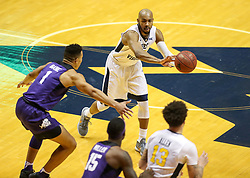 Feb 12, 2018; Morgantown, WV, USA; West Virginia Mountaineers guard Jevon Carter (2) passes the ball during the first half against the TCU Horned Frogs at WVU Coliseum. Mandatory Credit: Ben Queen-USA TODAY Sports