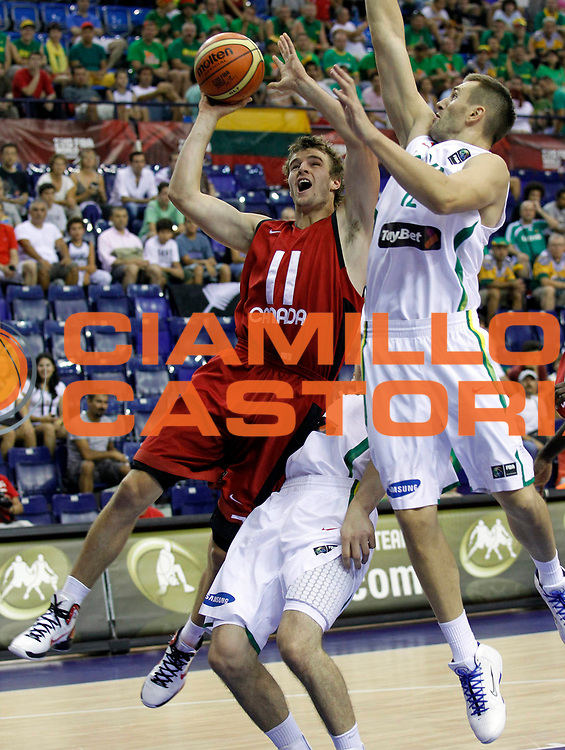 DESCRIZIONE : Izmir Turchia Turkey Men World Championship 2010 Campionati Mondiali Lithuania Canada<br /> GIOCATORE : Aaron Doornekamp<br /> SQUADRA : Canada<br /> EVENTO : Izmir Turchia Turkey Men World Championship 2010 Campionato Mondiale 2010<br /> GARA : Lithuania Canada Lituania Canada<br /> DATA : 29/08/2010<br /> CATEGORIA : tiro shot<br /> SPORT : Pallacanestro <br /> AUTORE : Agenzia Ciamillo-Castoria/M.Kulbis<br /> Galleria : Turkey World Championship 2010<br /> Fotonotizia : Izmir Turchia Turkey Men World Championship 2010 Campionati Mondiali Lithuania Canada<br /> Predefinita :