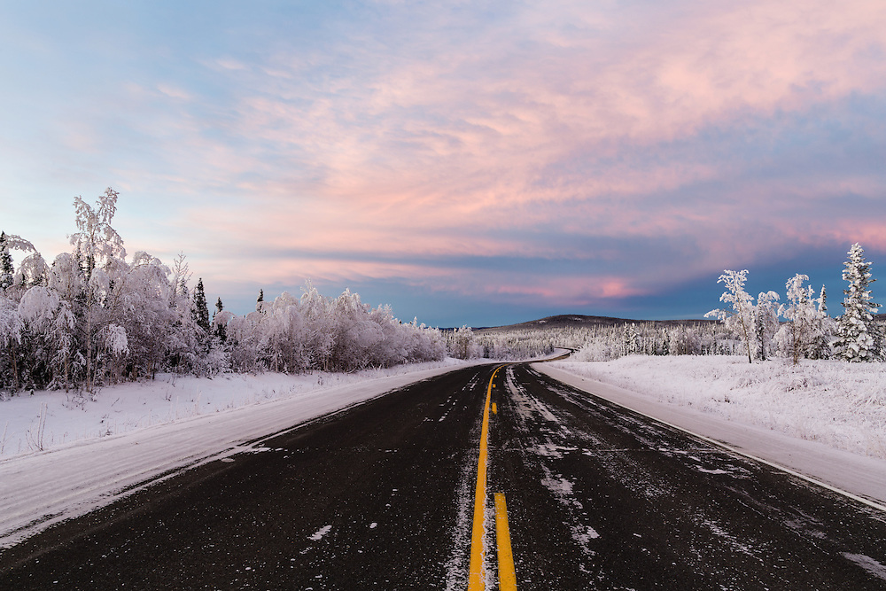 Alpenglow and sunset along the Alaska Highway somewhere near the border with Canada.  Winter. Afternoon.