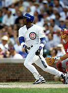 "CHICAGO, IL-SUMMER 1998:   Sammy Sosa of the Chicago Cubs connects for his 56th home run at Wrigley Field in Chicago, Illinois during the 1998 season.  Sammy Sosa and Mark McGwire were part of what has been called the ""Great Home Run Race of 1998"" between the two as they were both attempting to break the single season home run record of 61 held by Roger Maris since 1961.  (Photo by Ron Vesely)"