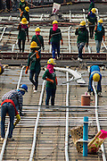 22 FEBRUARY 2013 - BANGKOK, THAILAND: Workers install conduit on the Siam Square 1 construction site. Siam Square 1 is a new retail development under construction on Th. Rama I between Henri Durant and Phaya Thai across the street from Siam Center. It will join a very crowded retail environment in the Ratchaprasong Intersection area that includes Siam Center, Siam Paragon, Gaysorn, Erawan and MBK.     PHOTO BY JACK KURTZ
