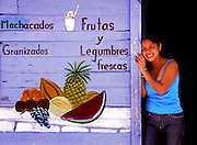Local merchant selling fruit in the family store in the town center on the Isla de Holbox, Mexico.
