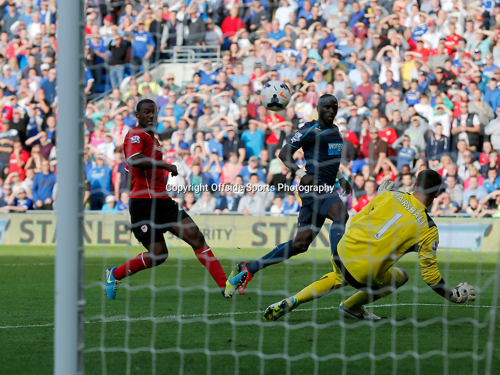 5th October 2013- Barclays Premier League - Cardiff City Vs Newcastle United - Moussa Sissoko of Newcastle United flicks a ball over Cardiff keeper David Marshall only to see his shot curl wide - Photo: Paul Roberts / Offside.