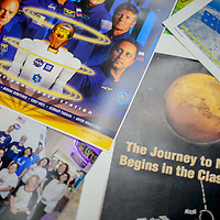 Debbie Tomac returned from the National Aeronautics and Space Administration headquarters in Houston with a collection of photographs and NASA mission posters.
