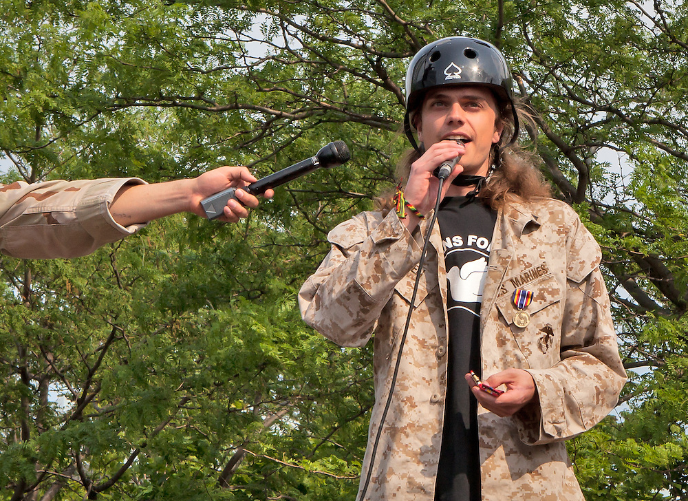 Scott Olson, speaking at Anti-Nato Protest in Chicago before throwing his war metals away. Today he recieved a 4.5 million dollar settlement from the Oakland Police who shot in during an Occupy proetst with a bean bag causing him brain damage.