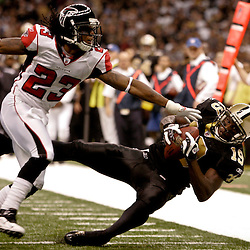 2009 November 02:  New Orleans Saints wide receiver Devery Henderson (19) makes a catch over Atlanta Falcons cornerback Chris Houston (23) during the second quarter at the Louisiana Superdome in New Orleans, Louisiana.
