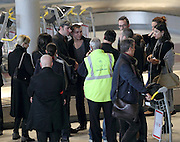 """28.FEBRUARY.2012. PARIS<br /> <br /> JEAN DUJARDIN IS SEEN ARRIVING AT ROISSY CHARLES DE GAULLE AIRPORT FROM LOS ANGELES ALONG WITH HIS FRIEND GILLES LELLOUCHE TUESDAY AFTERNOON. THE ACTOR WHO JAS JUST WON THE OSCAR FOR BEST ACTOR FOR HIS PERFORMANCE IN """"THE ARTIST"""" WAS WELCOMED BY DOZENS OF JOURNALISTS AND FANS.  <br /> <br /> BYLINE: EDBIMAGEARCHIVE.COM<br /> <br /> *THIS IMAGE IS STRICTLY FOR UK NEWSPAPERS AND MAGAZINES ONLY*<br /> *FOR WORLD WIDE SALES AND WEB USE PLEASE CONTACT EDBIMAGEARCHIVE - 0208 954 5968*"""