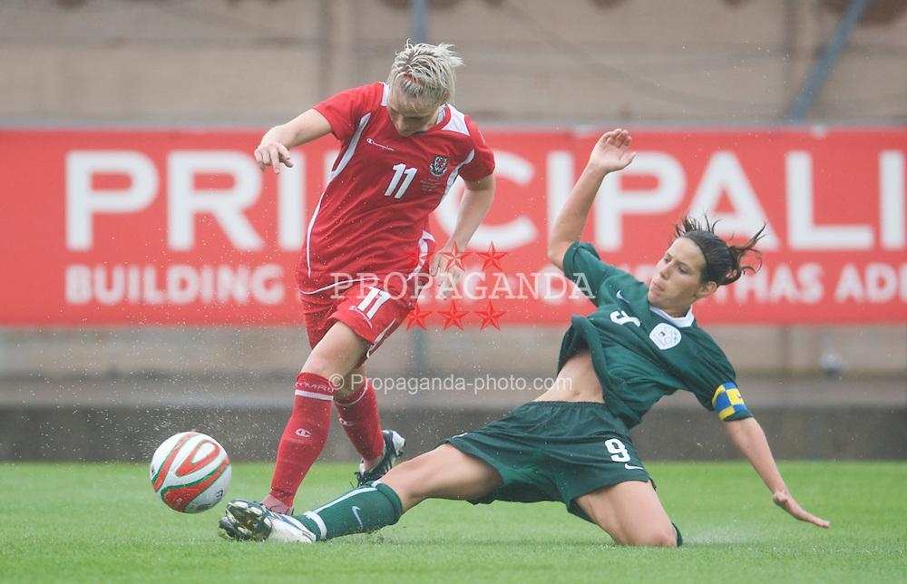 LLANELLI, WALES - Sunday, August 23, 2009: Wales' Jessica Fishlock in action against Slovenia's captain Manja Benak during a friendly international match at Stebonheath Park. (Pic by David Rawcliffe/Propaganda)