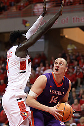 "03 February 2018:  Dainius Chatkevicius defended by Daouda ""David"" Ndiaye during a College mens basketball game between the Evansville Purple Aces and Illinois State Redbirds in Redbird Arena, Normal IL"