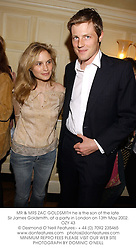 MR & MRS ZAC GOLDSMITH he is the son of the late Sir James Goldsmith, at a party in London on 13th May 2002.	OZY 43