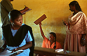 Nirmala Kunjibabu, 15, continued to excel at school despite the loss of her mother to the tsunami in Nagappattinam, on the southeastern coast of India. As her father died when she was young, Kunjibabu is now cared for by an orphanage. .At the Natarajan Dhamayanthi High School, five students were swept away by the waves, 112 lost one parent and 42 students lost both parents. .The December 26, 2004 tsunami killed thousands of people along this coast, smashing boats, roads and houses and tearing thousands of families apart. .Picture taken February 2005 in Nagapptinam, Tamil Nadu, India, by Justin Jin