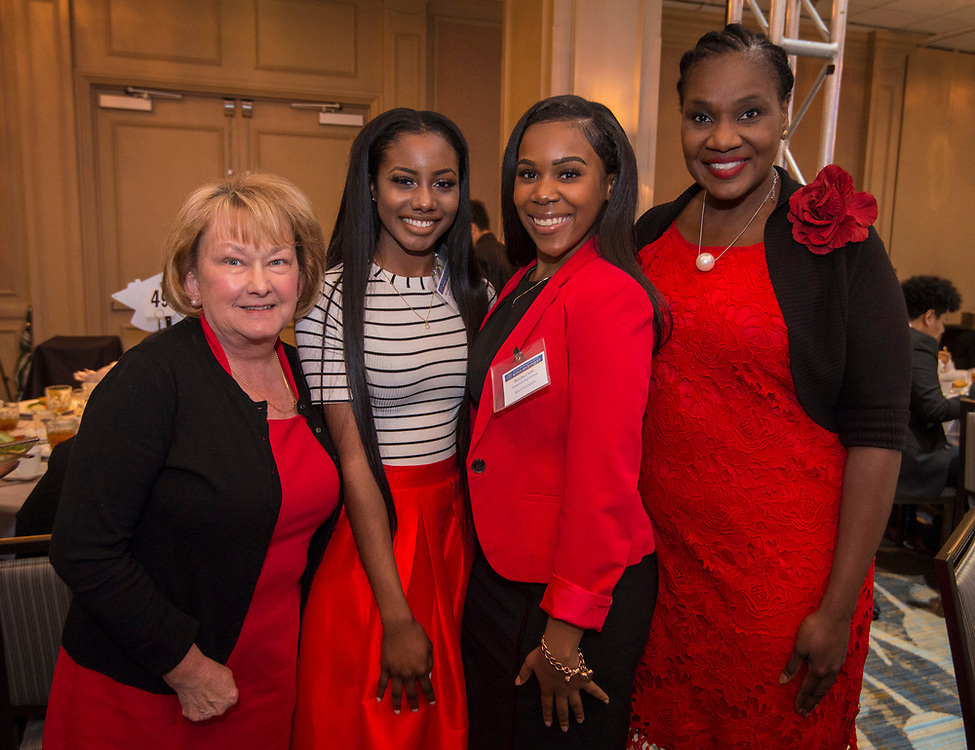 Houston ISD Trustee Wanda Adams poses for a photograph with students during the Scholars Banquet at the Westin Galleria, April 11, 2017.