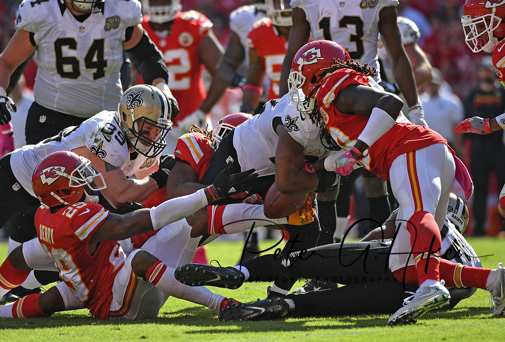 KANSAS CITY, MO - OCTOBER 23:  Running back Mark Ingram #22 of the New Orleans Saints fumbles the ball, as defensive back Ron Parker #38 of the Kansas City Chiefs punches the ball lose during the second half on October 23, 2016 at Arrowhead Stadium in Kansas City, Missouri.  (Photo by Peter Aiken/Getty Images) *** Local Caption *** Mark Ingram;Ron Parker