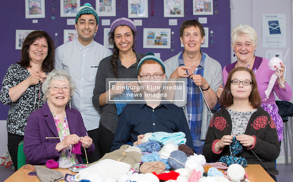 Pictured: Georgette Avids, Zeyn Mohammed (Parliament Assistant) Pinar Aksv, Ross Greer ,Jennifer Gray, Helen Hay, Janet Andrews,  Ross Greer (MSP Green Party)and Ashley Holdsworth<br /> <br /> Ross Greer MSP visited Knit for Unity: Across the Globe, today  bringing a donation of wool from a knitting group at Bearsden Baptist Church. <br /> <br /> Knit for Unity was founded in November 2015 as a direct response to the developing humanitarian crisis in the Eastern Mediterranean, making hats, scarves and blankets for people in desperate need. The group has been widely supported with donations of wool and finished items, and has distributed finished knitwear to people in Lesvos and Calais. They have also supported recent arrivals from Syria, young families supported by Home Start, and people using night shelters in Glasgow. Knit for Unity meets every Monday at Maryhill Integration Network. <br /> <br /> © Karen Gordon Edinburgh Elite media 20 June 2016