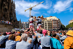 Castellers building human towers at the Sagrada Família, Barcelona, Catalonia, Spain<br /> <br /> (c) Andrew Wilson | Edinburgh Elite media
