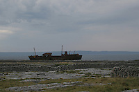 Dark light over shipwreck on Inis Oirr the Aran Islands Galway Ireland