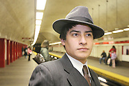 (Boston, MA - February 21, 2007) - Standing inside the Park Street subway station, Boston University sophomore Chris Pastorino sports a charcoal fedora and a matching three piece suit...Staff Photo Will Nunnally/Will Nunnally Photography