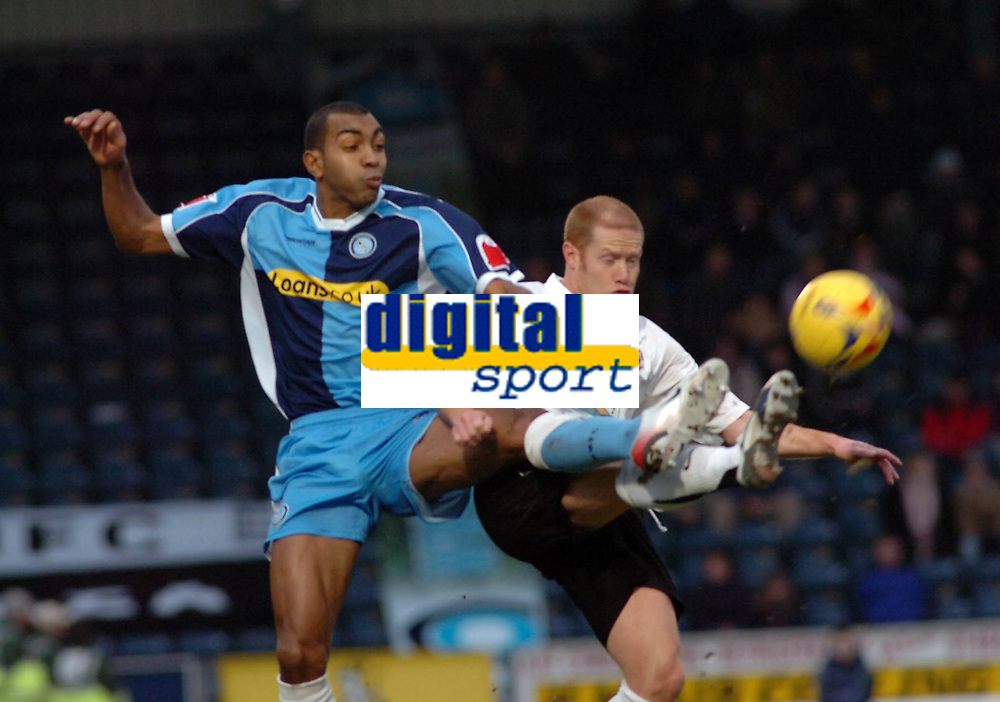 Photo: Kevin Poolman.<br />Wycombe Wanderers v Hereford United. Coca Cola League 2. 01/01/2007. Wycombe's Kevin Betsy and Simon Travis of Hereford both go in for the ball.
