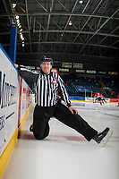 KELOWNA, CANADA - APRIL 14: Linesman Nathan VanOosten stretches on the ice at the Kelowna Rockets' bench against the Portland Winterhawks on April 14, 2017 at Prospera Place in Kelowna, British Columbia, Canada.  (Photo by Marissa Baecker/Shoot the Breeze)  *** Local Caption ***