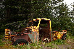 Rusted and abandoned yellow pick up truck, Lake Clark National Park, Alaska, United States of America